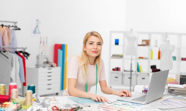 Fashion Designer Sitting At Desk