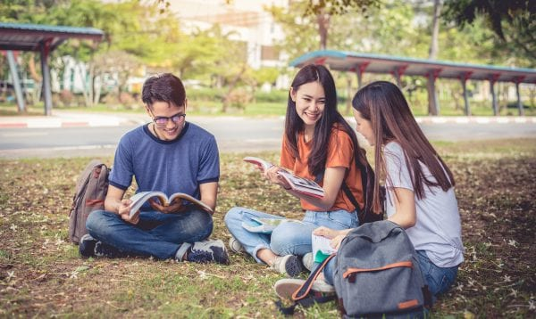 Group Of Asian College Student Reading Books And Tutoring Specia