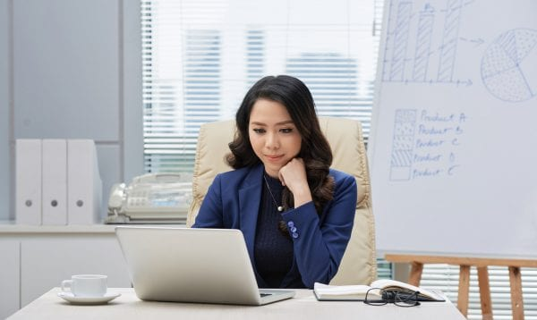 Attractive Asian Entrepreneur At Work