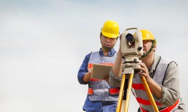 Surveyor Engineer Making Measure With Tablet Pc